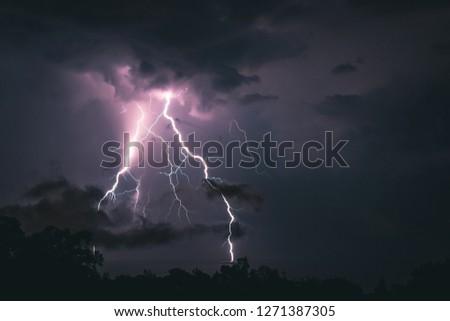 Lightning storm and boat Stock fotó ©
