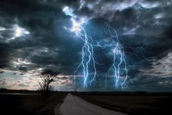 Lightning storm over asphalt road