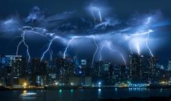 Lightning storm over city in blue light