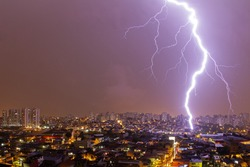 Lightning storm over the Sao Paulo city in purple night