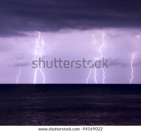 Lightning storm over the sea at night