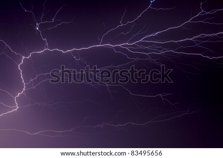 Lightning streaks and branches across the night sky in dramatic fashion over Indiana in the Midwest of the United States of America.