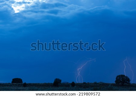 Lightning streaks through the sky during a summer thunderstorm near Apple Valley, Utah.
