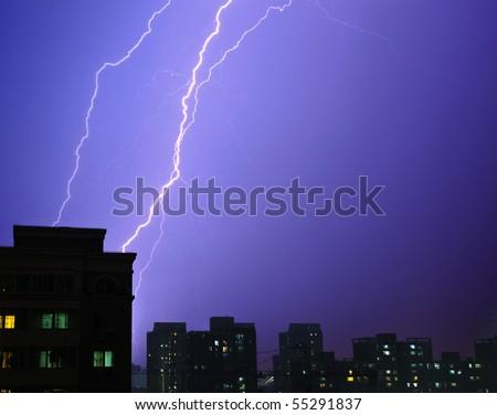 Lightning strike at summer night in city
