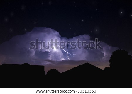 Lightning strike in a dark local neighborhood during a power outage and star field background