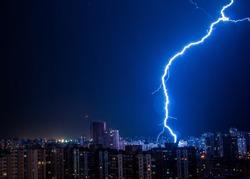 Lightning strike in the city Kyiv.. Storm outside. Thunderstorm with lightning in the city. Moment lightning