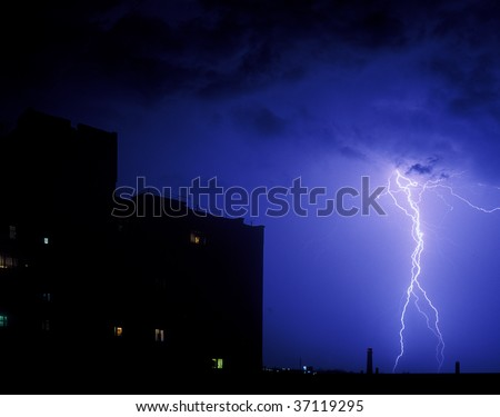 Lightning strike in the night over a city