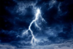 Lightning strike on a cloudy dramatic stormy sky.