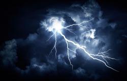 Lightning strike on the cloudy dark sky.
