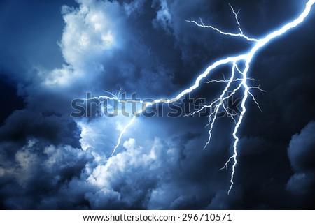 Lightning strike on the cloudy dark sky