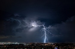 Lightning Strike Over City Lights