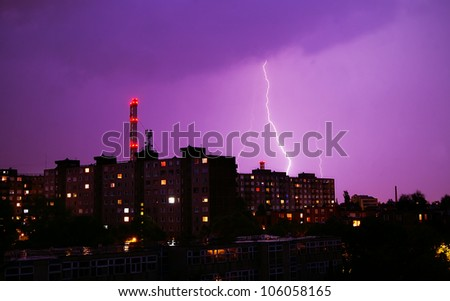 Lightning strike over dark  sky in night city