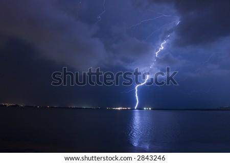 Lightning strike over lake