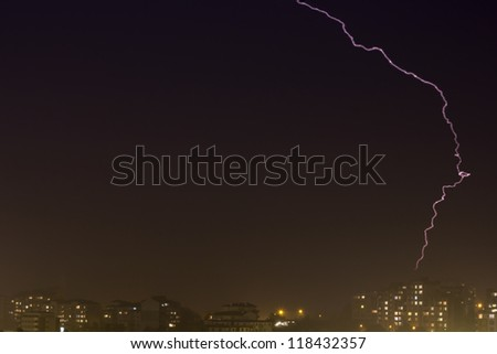 Lightning strike over night city
