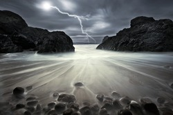 Lightning strikes between rock at Kynance Cove, Cornwall