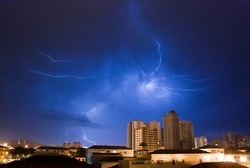 Lightning strikes in the night city sky before the storm