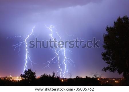 Lightning strikes over city