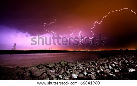 LIghtning Strikes over rocks and water