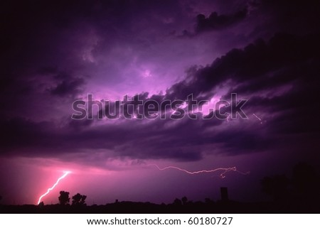 Lightning strikes the ground during a summer thunderstorm near Rockford, Illinois.