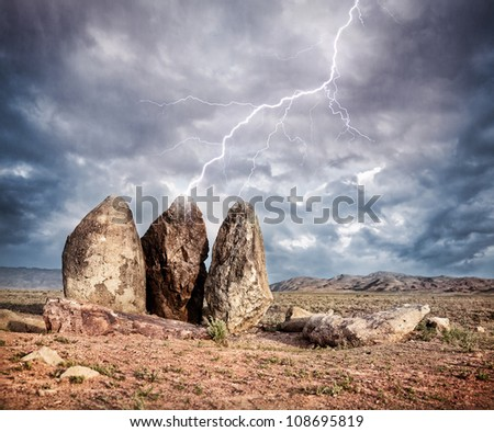 Lightning strikes three big stones in the steppe of Kazakhstan, central Asia