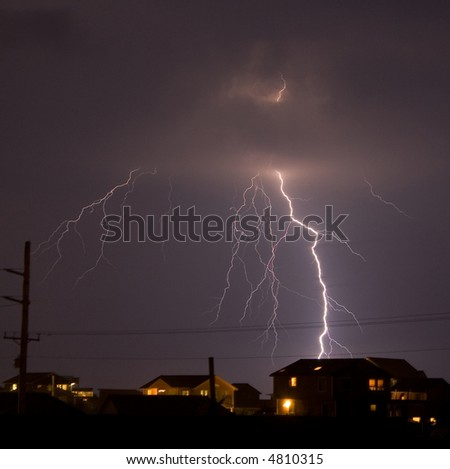 Lightning striking a residential area.