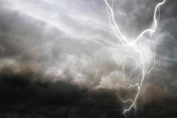 Lightning striking the dark cloud sky