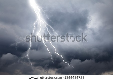 Photo of  Lightning thunderstorm flash over the  sky.