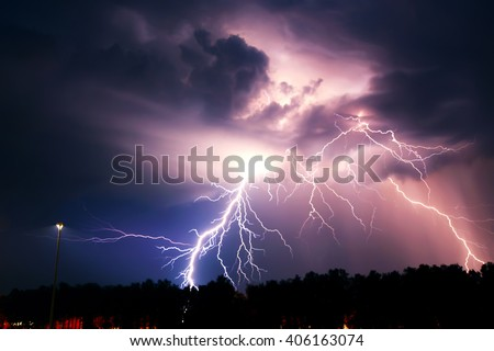 Lightning with dramatic clouds (composite image). Night thunder-storm