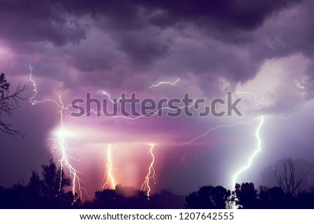Lightning with dramatic clouds. Night thunder storm. #1207642555