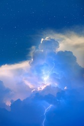 Lightnings in storm clouds with stry sky -  Peals of a thunder and the sparkling lightnings in clouds
