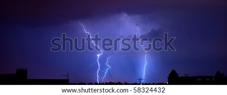 Lightnings in the night sky over a city