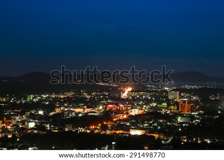 Lights and buildings of coastal city in night time