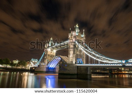 Lights and Colors of Tower Bridge at Night reflected on Thames River - London - UK