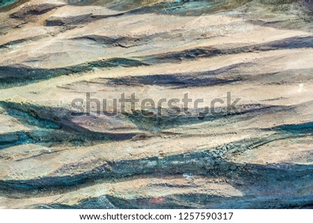 Lights and shadows of a grooved brown surface background and texture