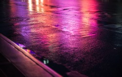 Lights and shadows of New York City. Abstract blurred image of NYC streets after rain with reflections on wet asphalt