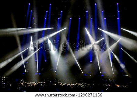 Lights and SpotLights on the stage during live concert with many people #1290271156