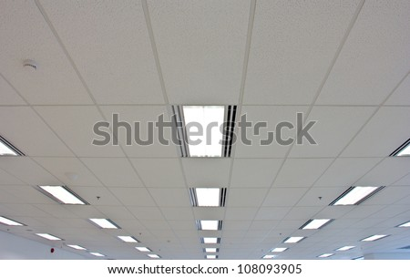 Lights from ceiling of business office building