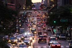 Lights from crosstown traffic on 42nd Street in Midtown Manhattan New York City