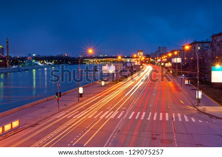lights from the headlights in motion blur postural evening. Frundzenskaya embankment of the Moscow River. Moscow.