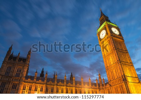 Lights of Big Ben at Dusk with blurred moving cloud - London - UK