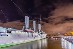 Lights of Saint Petersburg - night view of famous battleship Aurora near the centre of the St. Petersburg city (former Leningrad) with many lights and beautiful sights.