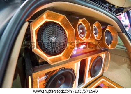 lights of stereo and speakers in car in the night