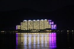 Lights of the hotel reflected in the sea