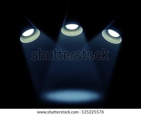 Lights on a black foneTri lamp on a black background