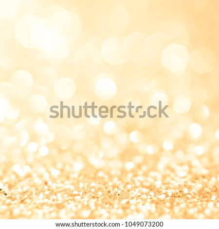 Lights on gold background. abstract blink for christmas silver sparkle glitter backdrop bokeh bright blur for xmas and happy new year celebration card decoration holiday art golden