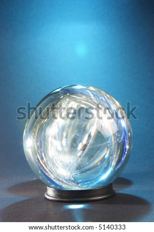 lights within crystal ball against blue