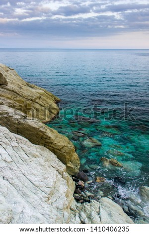 ligurian cerulean sea and rocks in spring #1410406235