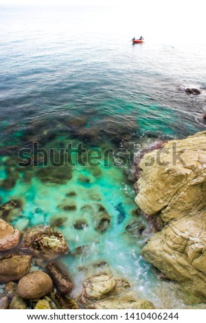ligurian cerulean sea and rocks in spring #1410406244