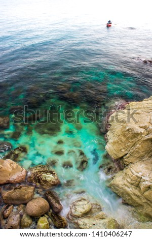 ligurian cerulean sea and rocks in spring #1410406247