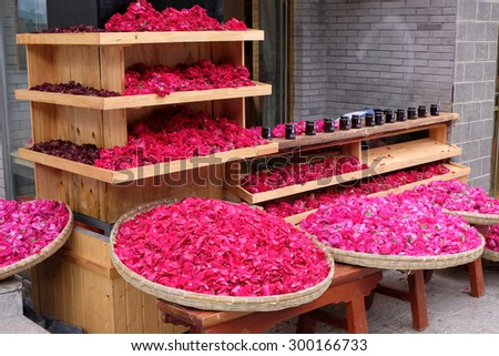 LIJIANG, CHINA, April 28, 2015: Rose shop in Lijiang ancient town in Yunnan, China. Lijiang is one of the most beautiful cities of China with a rich culture and history.